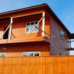dom wykończony w drewnie castorama